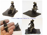 Nice old tiny Vienna Bronze black boy hat seatting smoking americana