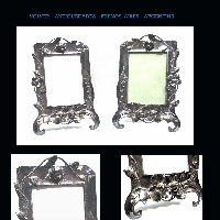 Interesting antique metal Art Nouveau pair of silver plated picture frame putto flowers